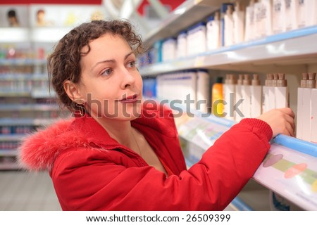 young woman in shop of household cosmetics
