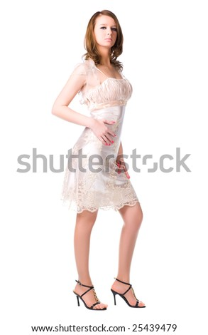 Young woman in silver dress. Isolated on white.