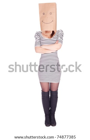 young woman in smiling ecological paper bag on head, series