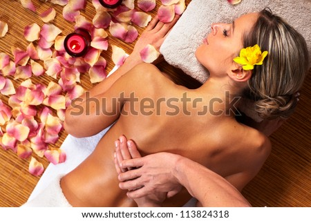 Young woman in Spa massage salon. Relax.