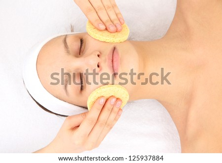 Young woman in spa salon