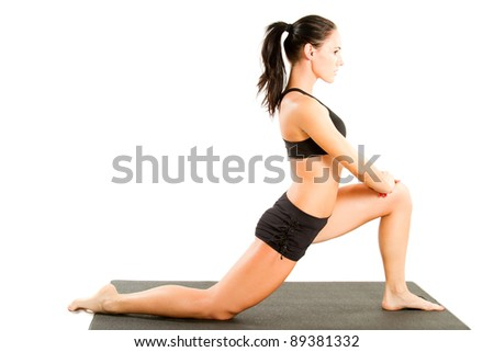 young woman in sports bra on yoga pose on isolated white background