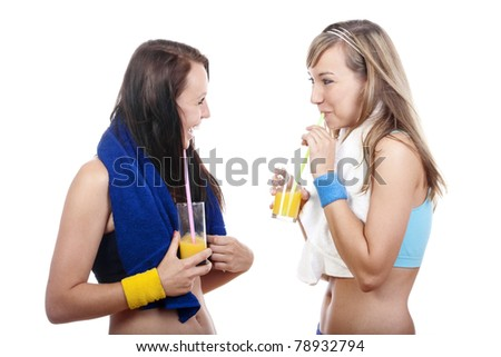 young woman in sports outfit drinking juice, talking - isolated on white