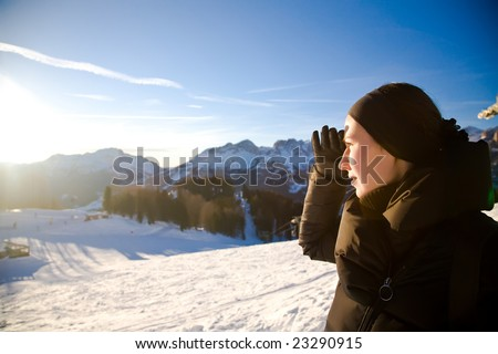 Young Woman In The Alps Mountains Looking Forward. Winter Sport Series.