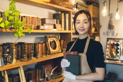 Young woman in the antique shop. Appraiser.