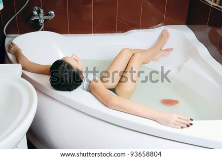 Young woman in the bath