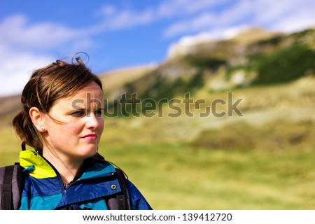 Young woman in the mountain. Summer landscape
