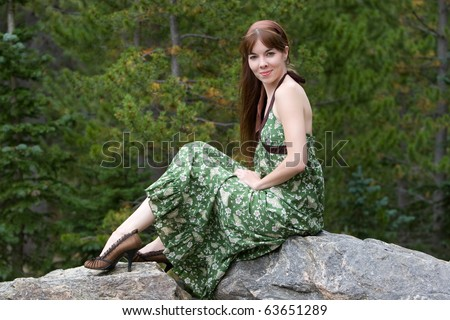 Young woman in the mountains