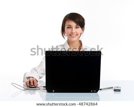 young woman in the office sitting at the table, in front of the notebook, on white background