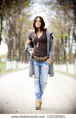 Young woman in the park - stock photo