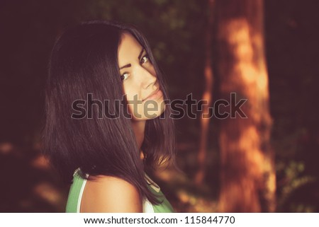 young woman in the park in autumn