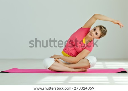 Young woman in the Pigeon yoga pose. Series