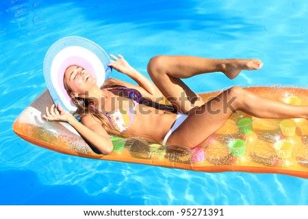 Young woman in the pool in greece