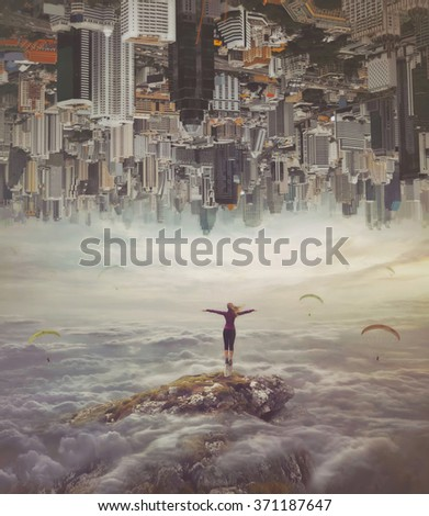 Stock Photo Young woman in the sky standing on a rock with divorced hands