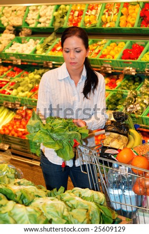 Young woman in the supermarket to buy food and a fruit