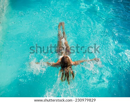 Young Woman in the swimming pool top view #230979829