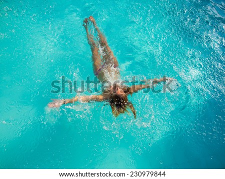 Young Woman in the swimming pool top view