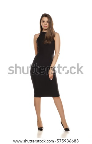 young woman in tight black dress on white background #575936683