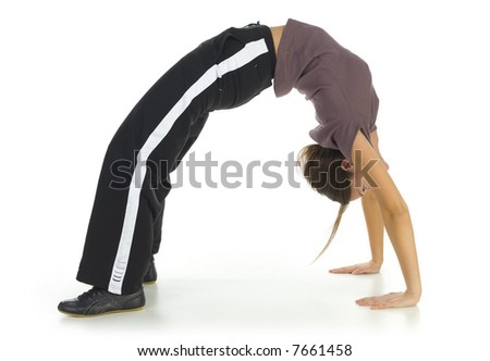 Young woman in tracksuit doing some kind of exercise. Isolated on white in studio. Side view, whole body