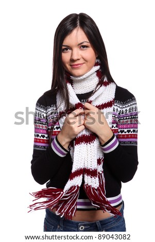 Young woman in warm sweater and scarf with happy smile