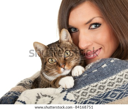 young woman in warm winter sweater with  cat