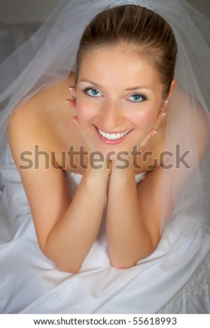 stock photo Young woman in wedding dress in studio