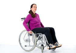 young woman in wheelchair in front of white background