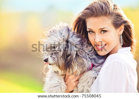 young woman in white shirt with dog outdoor portrait