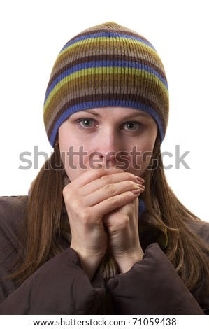 Young woman in winter clothes isolated over white background