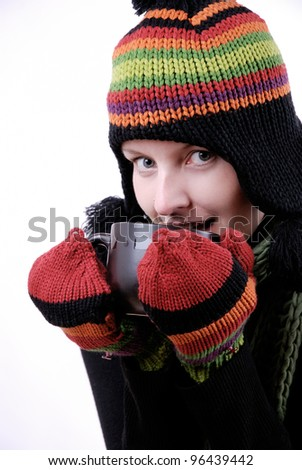 young woman in winter clothes with a cup of hot beverage
