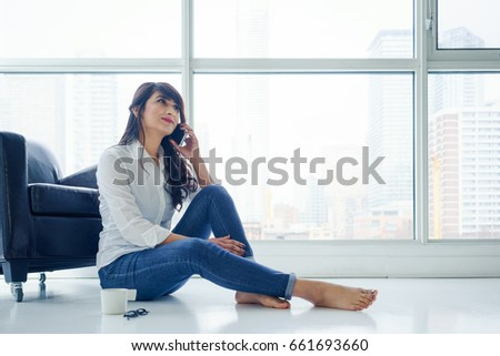 young woman indoors  sitting on ...