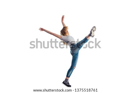 Young woman is doing amazing aerobic moves