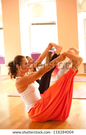 Young woman is doing yoga at sport club
