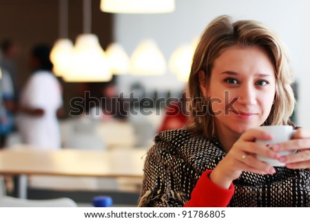 young woman is drinking coffee