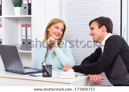 Young woman is flirting with her boss at work,Flirting at work - Shutterstock ID 171806711