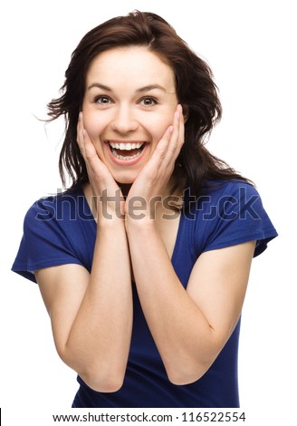 Young woman is holding her face in astonishment, isolated over white - stock photo