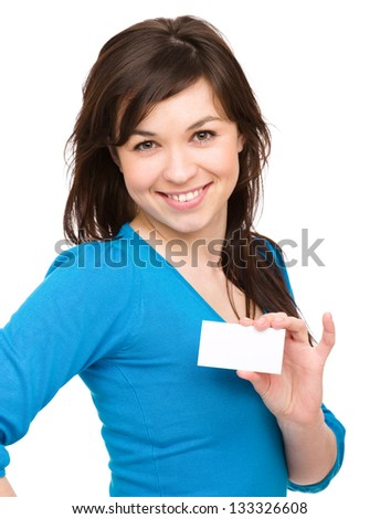 Young woman is holding visit card, isolated over white - stock photo