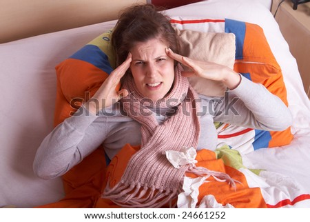 Young woman is ill in bed. She is feeling miserable. Ideal medical shot. - stock photo