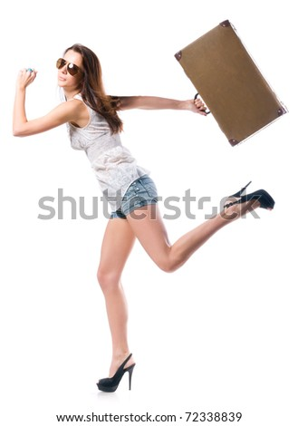 young woman is running with leather case, isolated on white background - stock photo