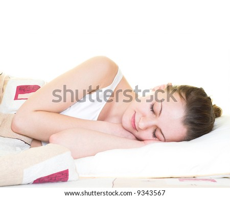 Young woman is sleeping in her bed. Isolated.