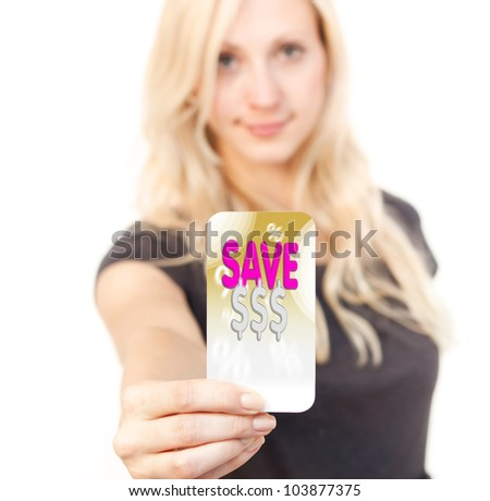 Young woman is smiling while showing bargain Card