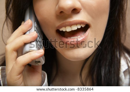 young woman is speaking on cell phone #8335864