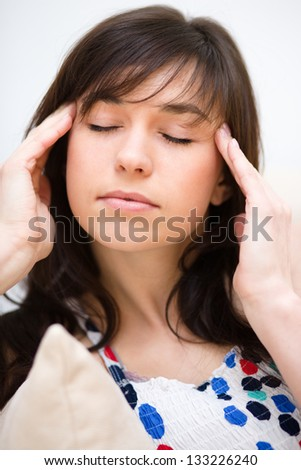Young woman is suffering headache