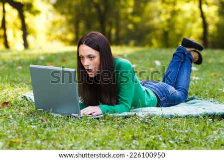 Young woman is surprised about something she had seen on her laptop,Surprised woman