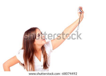 Young woman is taking photos with compact  camera, isolated on white background