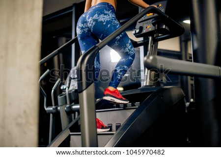 Young woman is working out on stairway