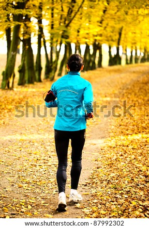 Young woman jogging in park. Health and fitness