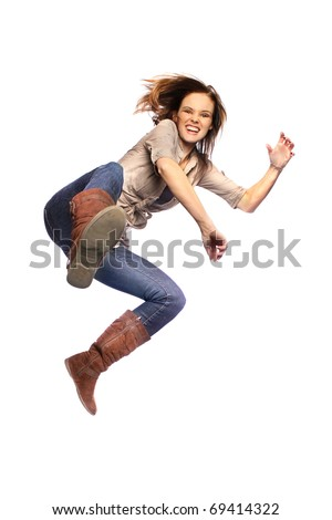 Young woman jump kicking in mid air - stock photo