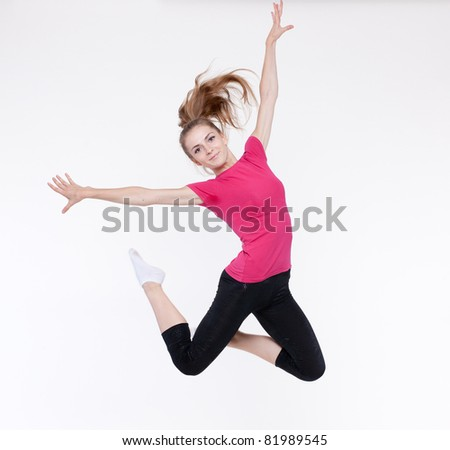 Young woman jump on white background