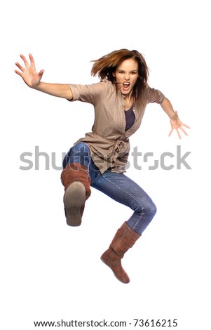 Young woman jumping and kicking